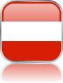 Man sieht im Bild die Flagge von Österreich auf einen Metallbutton plus Spiegel gestaltet. In Österreich gibt es 5 Bach Chöre, Bach Orchester oder Bach Vereine.