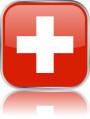 Man sieht im Bild die Flagge der Schweiz auf einen Metallbutton plus Spiegel gestaltet. In der Schweiz gibt es 6 Bach Chöre, Bach Orchester oder Bach Vereine.