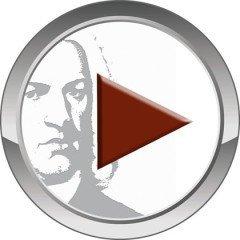 Im Bild sieht man einen einfachen kreisrunden Button, sehr modern in grau. Er hat einen Spiegel innen. Darauf: ein Teil des Bach Portraits in grau und ein rotes Dreieck als Play-Knopf-Aufforderung.