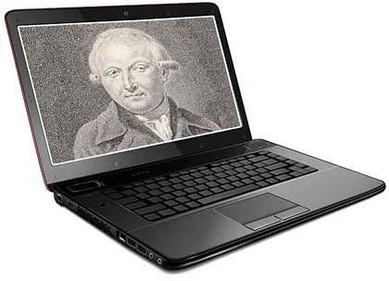 Das Bild zum Zitat zu Bach: ein ganz altes schwarz-weißes Foto von Forkel, sicher ein Stich. Montiert in die Screenfläche eines offenen Laptops der seitlich zum Betrachter auf weißem Grund steht.