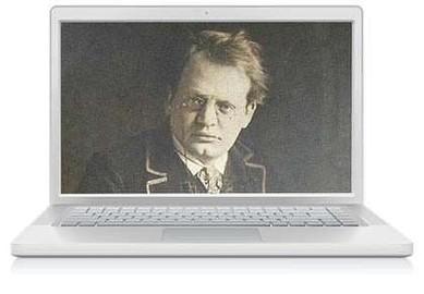 Das Bild zum Zitat zu Bach: ein ganz kontrastloses altes schwarzweißes Foto von Reger, er schaut in die Kamera, hat eine Brille, montiert in einen weißen Laptop, der offen zum Betrachter steht.