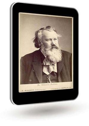 Das Bild zum Zitat zu Bach: der alte Wagner mit Vollbart und scheinbar ungekämmt, dunkler Anzug, große Schleife. Das Bild schwarzweiß, montiert in ein Tablet-PC, der schräg verkantet schwebt.