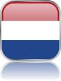 Man sieht im Bild die Flagge von Holland auf einen Metallbutton plus Spiegel gestaltet. In Holland gibt es einen Bach Chor und einen Bach Vereine.