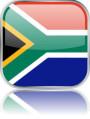 Man sieht im Bild die Flagge von Südafrika auf einen Metallbutton plus Spiegel gestaltet. In Südafrika gibt es zwei Bach Chöre.