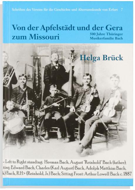 Das Buch, das das Thema Bach und die USA verbindet. Von der Gera an den Missouri von Helga Brück. Es zeigt ein graues Design mit hellblauen Anteilen.