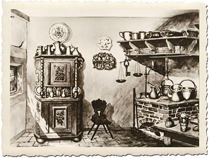 Das Bild der historischen Küche auf der Steckbrief-Seite: ein Schrank links, ein Stuhl, , ein gemauerter Herd mit Töpfen rechts darauf. Darüber zwei Regale. Hier kochte die Mutter von Johann Sebastian Bach.