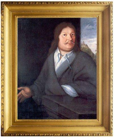 Im Bild sieht man das bekannte Portrait von Ambrosius, dem Vater von Johann Sebastian Bach. Im goldenen Barockrahmen. Es ist farbig, aber düster. Ambrosius sieht zur Kamera.
