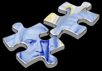 2 riesige Puzzle-Teile sind mit dem Portrait des blauen Kantors bedruckt. Beide Teile sind auf weißem Grund und haben einen Schatten.